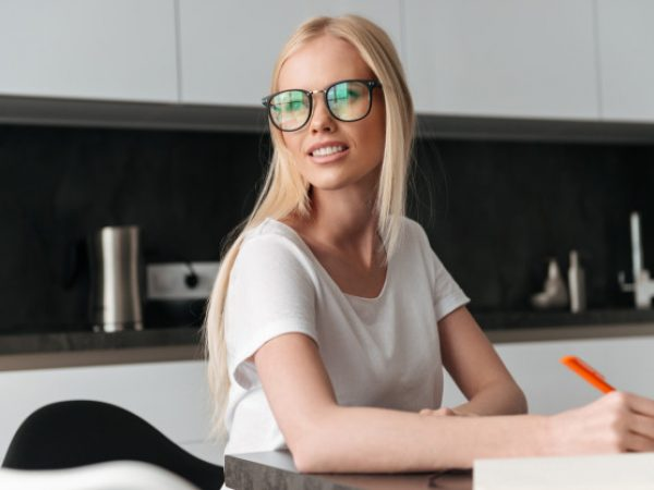 portrait-young-blonde-woman-working-home_171337-4896